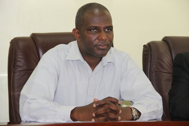 Terrance Crossman Chief Executive Officer of the St. Kitts and Nevis Sugar Industry Diversification Foundation at a handing over ceremony at the Ministry of Finance conference room on Nevis on June 24, 2014