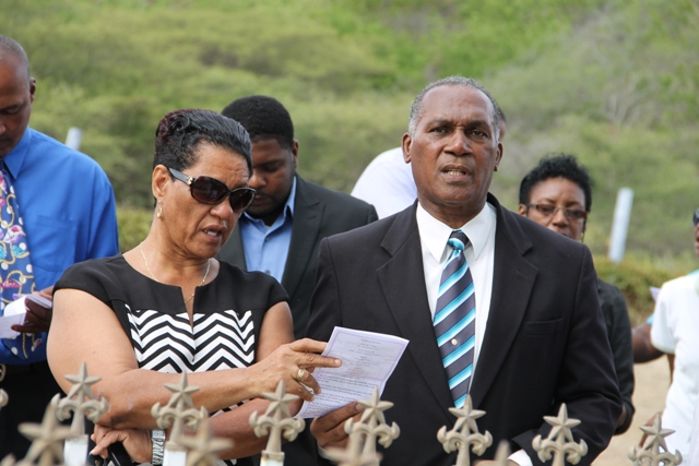 Widow of the late Malcolm Guishard Yvonne Guishard singing hymns at the gravesite of the late Malcolm Guishard during a memorial service at the Bath Cemetery on June 11, 2014. Guishard had served as Deputy Premier in the Nevis Island Administration before his passing seven years ago
