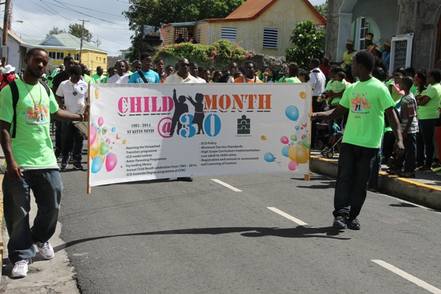The banner for the 30th annual Child Month Parade on show in Nevis during the Child Month Parade in Charlestown on June 06, 2014