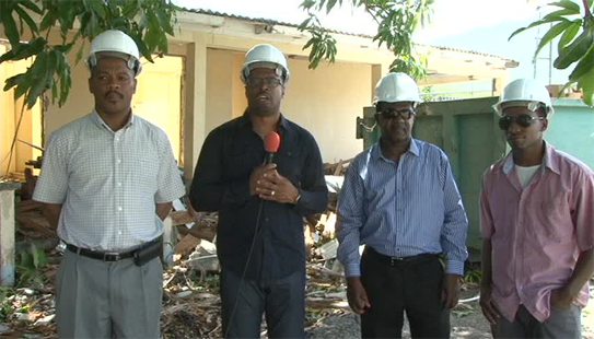 (L-R) Hospital Administrator Gary Pemberton, Deputy Premier of Nevis and Minister of Health Hon. Mark Brantley, Assistant Administrator Johnson Morton and Lefco Lefco Equipment Rental and Construction Co. Ltd. representative Randy Taylor at the start of demolition works of the old Nurse's Home at the Alexandra Hospital on June 20, 2014