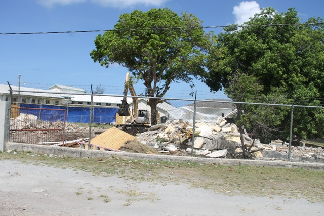 Ongoing demolition work at the old Nurse's Home on June 23, 2014, making way for the construction of a new diagnostic wing on the grounds of the Alexandra Hospital. Work started on June 20, 2014