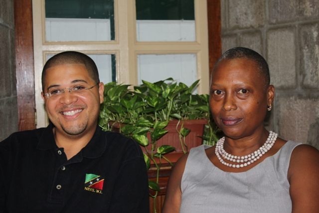 Michael Henville who is spearheading the new C40 Energy Drink Competition for the Culturama 40 festivities and Chairperson of the Culturama 40 Central Committee Deborah Tyrell at the Department of Information on June 12, 2014