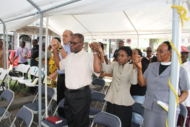 Members of the Nevis Christian Council and other members of the public at the church service they organized in collaboration with the Nevis Disaster Management Department on May 30, 2014, at the Memorial Square in Charlestown