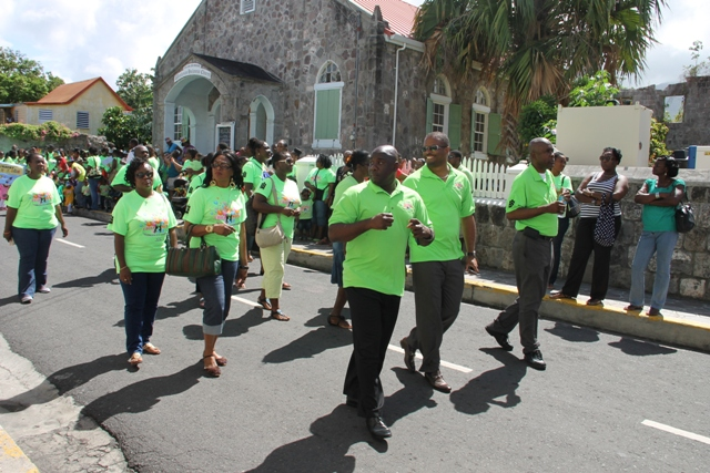 Acting Premier of Nevis Hon. Mark Brantley (middle front) leads colleague Ministers and other members of the Nevis Island Administration Cabinet at the 30th Child Month Parade in Charlestown on June 06, 2014