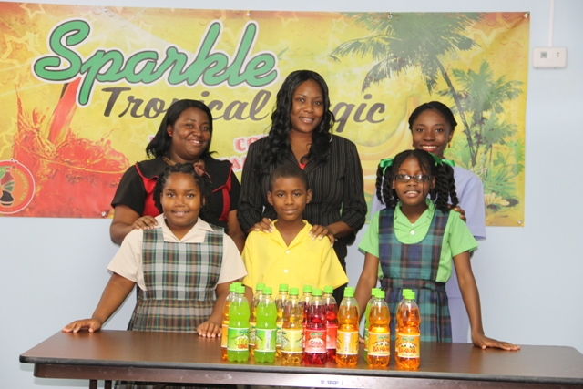 (l-r) Kaylan William and teacher Renee Anthony of the Charlestown Primary School, second place winner Tershean Wilkinson and teacher Trish Griffin of the St. Thomas Primary School, Destiny Lowe and teacher Cleanda Roberts of the Joycelyn Liburd Primary School at a brief ceremony hosted on May 29, 2014 at the TDC conference room located at Pinney's Industrial Estate