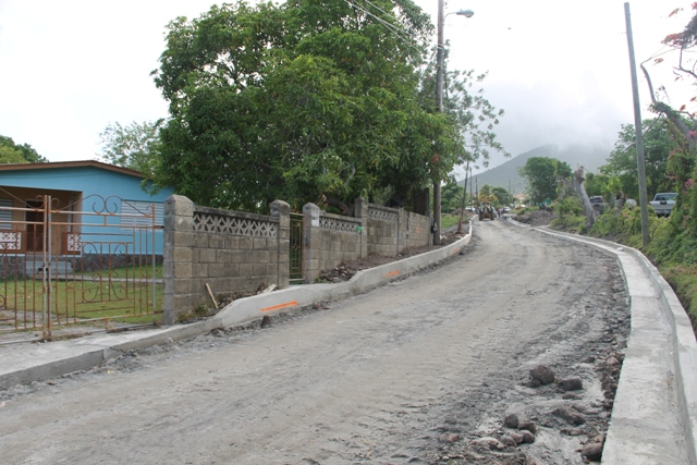 Ongoing work on another section of the Hamilton Road by the Public Works Department on June 20, 2014, in readiness for asphalting