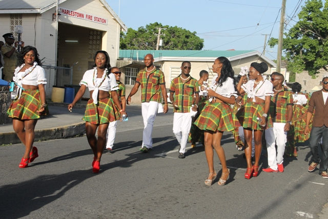 Participants for the Culturama 40 Miss Culture Swimwear and Mr. Kool contests dance through the streets of Charlestown moments before they were officially launched on June 13, 2014