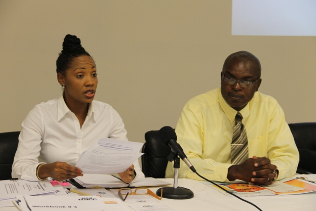 (L-R) Communications Specialist at the Organisation of Eastern Caribbean States (OECS) Secretariat Tecla Fortenard delivering remarks at a one-day consultation hosted by the OECS Secretariat in collaboration with the Nevis Island Administration on June 05, 2014 at the Emergency Operating Centre at Long Point and Ernie Stapleton Permanent Secretary in the Ministry of Communications, Works, Public Utilities, Posts, Physical Planning, Natural Resources and Environment on Nevis