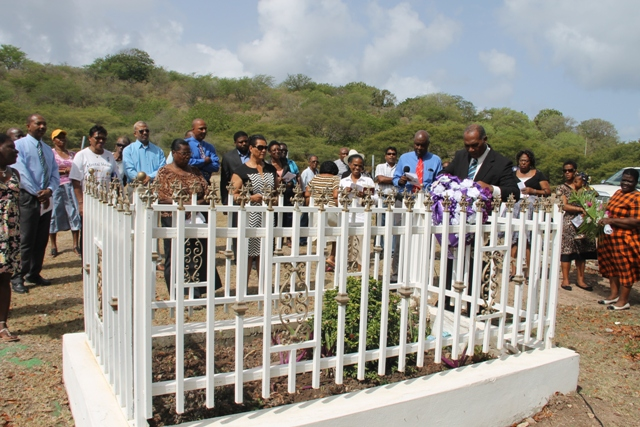 Premier of Nevis Hon. Vance Amory lays a wreath on behalf of the Nevis Island Administration at the grave site of the late Malcolm Guishard at a memorial service at the Bath Cemetery on June 11, 2014, to honour his memory after his passing seven years ago