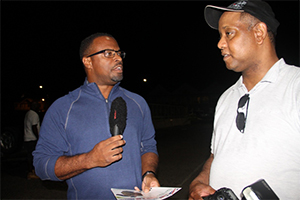 Deputy Premier of Nevis and Minister of Culture and Tourism Hon. Mark Brantley (r) and Chris Collins of JC Tours at the Charlestown Pier on July 29, 2014