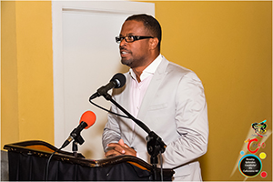 Deputy Premier and Minister of Culture in the Nevis Island Administration Hon. Mark Brantley delivering remarks at the Premier's Cocktail for Culturama 40 contestants on July 26, 2014 at the Nevis Performing Arts Centre courtyard