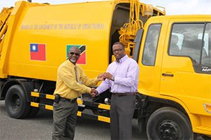 Deputy Premier and Minister of Health in the Nevis Island Administration Hon. Mark Brantley(r), on July 23, 2014, hands over the keys to a waste disposal truck, a gift from the Government and People of the Republic of China (Taiwan) to Chairman of the Nevis Solid Waste Management Authority Board of Directors Carlisle Pemberton at Long Point