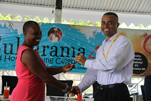 Ernie France, Managing Director of St. Kitts-Nevis-Anguilla Trading and Development Company (TDC Nevis Ltd.) officially handing over the keys to a red Toyota Yaris, valued at EC$80,000, to Culturama 40 Central Committee Chair Deborah Tyrell at a Culturama press briefing hosted at the Riviere House on Government Road on July 09, 2014. The car is a prize to be awarded to the winner of the 2014 Senior Kaiso Competition.