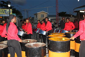 A steel pan welcome on the Charlestown Pier on July 29, 2014, for the arrival of The UK Invasion, a group from England organised by JC Tours taking part in the Homecoming and Culturama 40 Celebrations