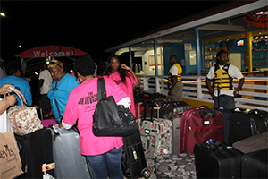 Lots of suitcases line the Charlestown Pier as members of Members of the UK Invasion, a group from England visiting Nevis for the Homecoming Celebrations and Culturama 40 Celebrations disembark from the MV Prince Devonte J at the Charlestown Pier on the evening of July 29, 2014