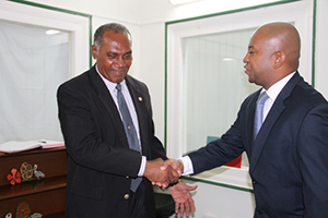 (L-R) Premier of Nevis Hon. Vance Amory welcoming new Organization of American States Representative to St. Kitts and Nevis His Excellency Terence Raymond Craig to his Bath Plain Office on August 21, 2014