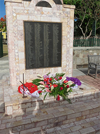 The Christena Disaster Memorial erected on the Charlestown Waterfront with wreaths at the end of a Memorial Service on August 01, 2014, to mark the 44th anniversary of the disaster in which 233 persons perished