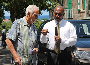 Retired businessman Charles Brisbane hands over the keys to a new Suzuki Grand Vitara to Premier of Nevis and Security Minister Hon. Vance Amory at Bath Hotel, Bath Plain on September 18, 2014