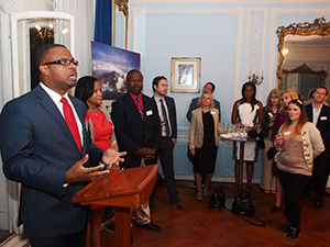 Deputy Premier of Nevis and Minister of Tourism Hon. Mark Brantley addresses invitees, among them travel agents, at a cocktail reception at the office of the High Commission of St. Kitts and Nevis in London. Looking on are (right) Chief Executive Officer of the St. Kitts Tourism Authority Raquel Brown and (second from right) Chief Executive Officer of the Nevis Tourism Authority Greg Phillip