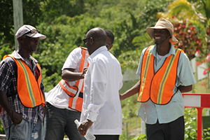 Prime Minister of St. Kitts and Nevis the Rt. Hon. Dr. Denzil Douglas talking to workers in the Nevis Water Supply Enhancement Project on October 08, 2014