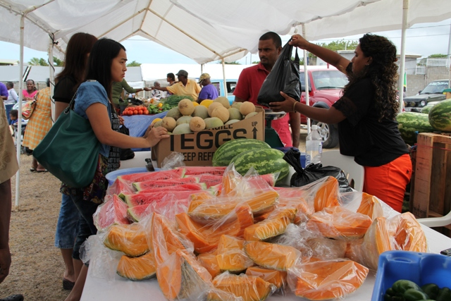 An abundance of locally grown fruits and vegetables on sale by farmers at the Agriculture Open Day on Nevis (file photo)