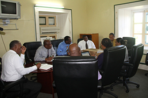 Premier of Nevis and Minister of Finance Hon. Vance Amory (extreme left) and Labour Commissioner in St. Kitts and Nevis Spencer Amory (extreme right) with other officials of the Premier's Ministry at a meeting at Bath Plain on October 06, 2014