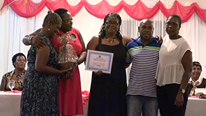 Children of the late Ms. Laura Blake of Brick Kiln Village accepting an award on behalf of their late mother from Junior Minister responsible for Social Development on Nevis Hon. Hazel Brandy-Williams, for her contribution to the development of Culture at the Gala and Awards ceremony hosted by the Department of Social Development, Seniors Division on October 23, 2014