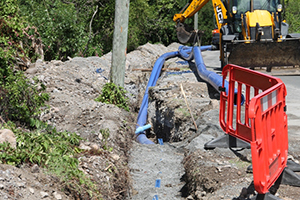 Laying water pipes on the Island Main Road in Maddens under the Nevis Water Supply Enhancement Project