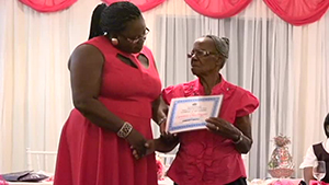 "Ms. Lucina ""Mama Lou"" Dore of Charlestown accepting an award from Junior Minister responsible for Social Development on Nevis Hon. Hazel Brandy-Williams, for her contribution to entrepreneurship at the Gala and Awards ceremony, hosted by the Department of Social Development, Seniors Division on October 23, 2014"