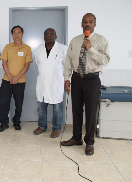(l-r) Andar International - Miami Technician Mr. Don Chin, Medical Chief of Staff at the Alexandra Hospital Dr. John Essien and Hospital Administrator Gary Pemberton at the commissioning ceremony of two new machines at the Alexandra Hospital on November 26, 2014