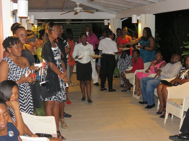 Some of the outstanding teens at a reception hosted by the Nevis Island Administration in their honour with other invited guests at the Mount Nevis Hotel on November 22, 2014
