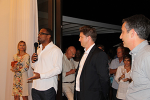 (L-R) Deputy Premier of Nevis and Minister of Tourism Hon. Mark Brantley, Managing Partner of St. Kitts/Nevis Residents and Citizenship from Henley & Partners Caribbean Ltd. Christopher Willis and Vice President of the FSRE Nevis David Chekemian at a cocktail party at Villa 2001 on November 20, 2014, to mark the official opening of Villas on Pinney's Beach