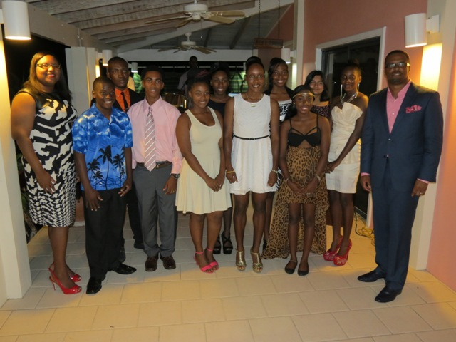 Coordinator of Youth Development Zahnela Claxton (extreme left) and Deputy Premier of Nevis and Senior Minister in the Ministry of Social Development Hon. Mark Brantley (extreme right) with some of the outstanding teenagers on Nevis recognised for their excellence, at a reception at the Mount Nevis Hotel on November 22, 2014.