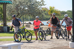 More cruise visitors to Nevis leaving the Charlestown Waterfront for a bicycle tour moments after they were brought to shore on November 19, 2014