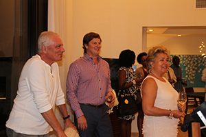 Four Seasons Resort Estates Nevis' new Director of Sales and Marketing Eric Johnson (middle) with guests at a cocktail party on November 20, 2014 at Villa 2001, to mark the official opening of Villas on Pinney's Beach