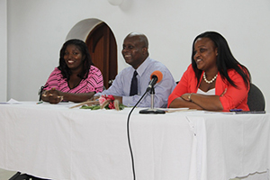 (L-R) Chairperson at the opening ceremony of the Nevis Public Library's 8th annual International College Fair Shariska Browne, Permanent Secretary in the Premier's Ministry Mr. Wakely Daniel and Featured Speaker Ms. Kerrilyn Edwards sitting at head table on November 17th, 2014, at the Nevis Public Library's 8th annual International College Fair, at the St. Paul's Anglican Parish Hall