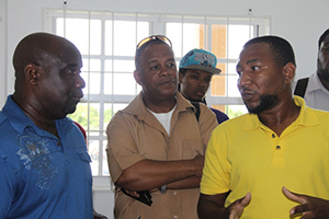(L-R) Minister of Agriculture on Nevis Hon Alexis Jeffers, Permanent Secretary in the Ministry of Agriculture Eric Evelyn, Manager of the Nevis Agro Processing Centre Dwight Brown touring the Centre at Prospect on November 04, 2014