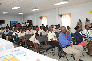 Front row (L-R) Cabinet Secretary in the Nevis Island Administration Steadmond Tross, Permanent Secretary in the Ministry of Education Lornette Queeley- Connor and Permanent Secretary of Human Resources Ornette Herbert with students from the Charlestown and Gingerland Secondary Schools at the Nevis Public Library's 8th annual International College Fair on November 17, 2014, at the St. Paul's Anglican Parish Hall