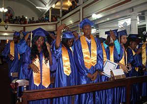 The Charlestown Secondary School Graduating Class of 2014 turn their tassels during their graduation ceremony at the Charlestown Methodist Church on November 12, 2014