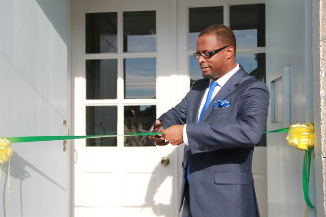 Minister of Tourism Hon. Mark Brantley cutting the ribbon at the opening ceremony of the Nevis Tourism Authority Visitor Centre.