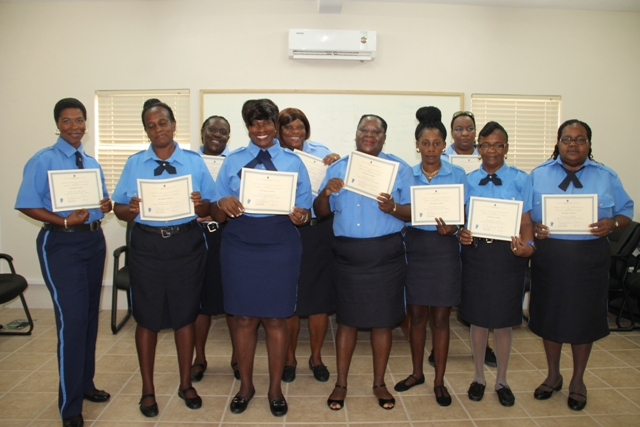 Graduands of the Royal St.Christopher and Nevis Police Force Traffic Wardens Training Course at the closing ceremony on December 5th, 2014, at the Cotton Ground Police Station