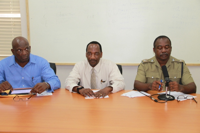 (L-R) Assistant Commissioner of Police Robert Liburd, Assistant Secretary in the Premier's Ministry Kevin Barrett and Chairperson of the closing ceremony Inspector Conrad Bertie sitting at the head table at The Royal St.Christopher and Nevis Police Force Traffic Wardens Training Course Closing Ceremony on December 5th, 2014, at the Cotton Ground Police Station