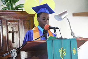 Randal Williams gives his Valedictory speech at the 41st annual Graduation Ceremony of the Gingerland Secondary School at the Gingerland Methodist Church on November 27, 2014