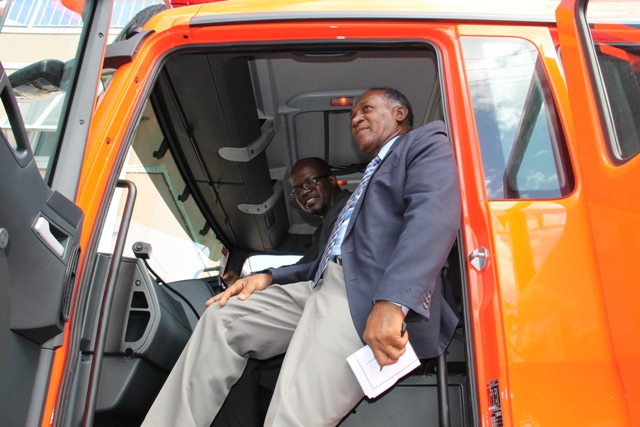 Premier of Nevis Hon. Vance Amory joins Federal Minister of Homeland Security Hon. Patrice Nisbett to inspect the new fire tender moments after it was handed over to the St. Kitts-Nevis Fire and Rescue Services Nevis Division in Charlestown on December 17, 2014