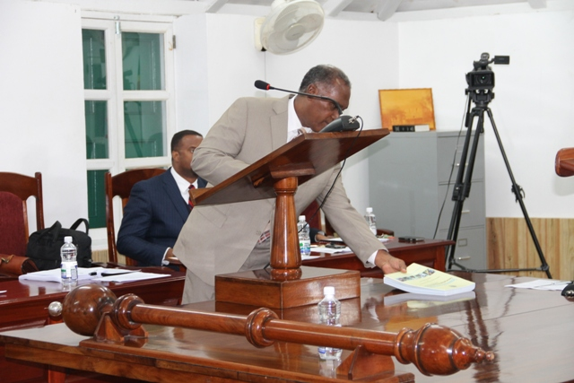 Premier of Nevis and Minister of Finance Nevis Island Administration Hon. Vance Amory tables The Draft Estimates 2015 at the Nevis Island Assembly sitting on December 16, 2014