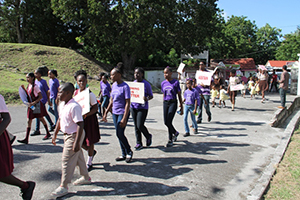 Students taking part in the World Aids Day March in Charlestown on December 01, 2014