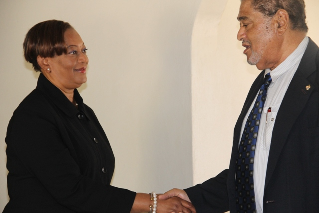 Deputy Governor General His Honour Eustace John congratulates Justice Lorraine Williams on her appointment as the new Resident Judge of the St. Christopher and Nevis High Court, Nevis Circuit at his Bath Plain Office on January 12, 2015