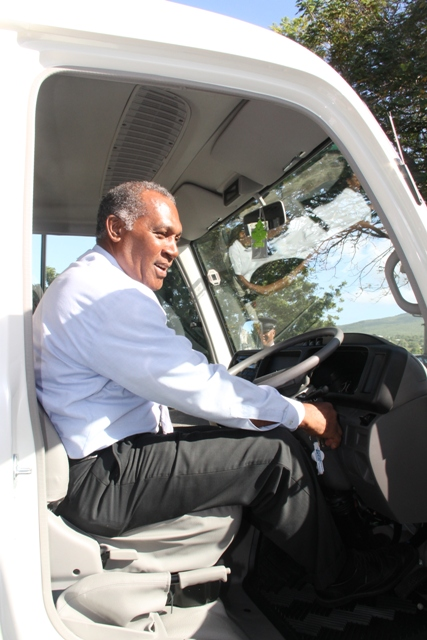 Premier of Nevis Hon. Vance Amory at the controls of the Brand new $202,500 Toyota Coaster Bus purchased by the Nevis Island Administration for the Department of Education's School Bus programme on Nevis