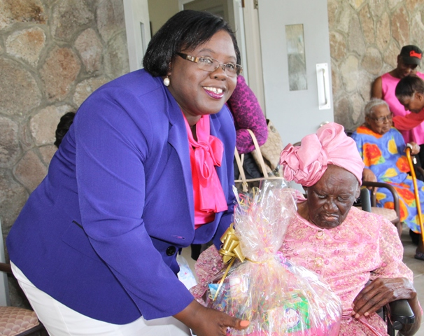 "Minister of Social development who is responsible for the welfare of the seniors on Nevis Hon. Hazel Brandy-Williams hands over a fruit basket to 103-year-old Celian ""Martin"" Powell during her birthday celebration on January 19, 2015, at the Flamboyant Nursing Home"