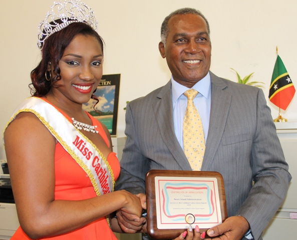 Reigning Miss Caribbean Culture Queen Yarani Morton presenting a token of appreciation to Premier of Nevis Hon. Vance Amory at his Bath Hotel office on January 15, 2015